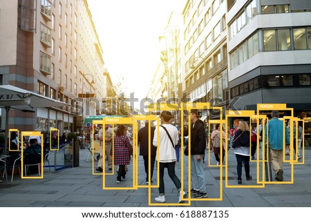 Machine Learning analytics identify person technology , Artificial intelligence concept. Software ui analytics and recognition people in city with flare light effect (blur all human face) Royalty-Free Stock Photo #618887135