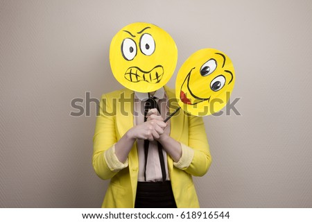 Development of emotional intelligence. The girl plays with smiles, builds faces. #618916544