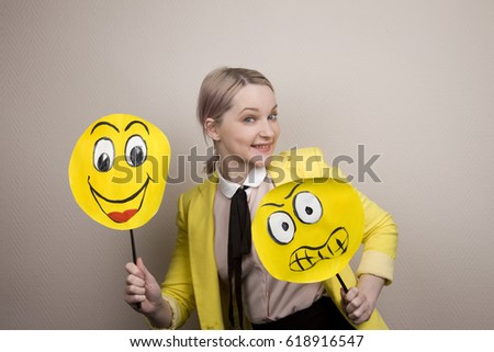Development of emotional intelligence. The girl plays with smiles, builds faces. #618916547