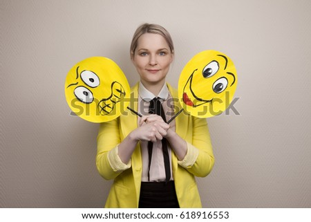 Development of emotional intelligence. The girl plays with smiles, builds faces. #618916553