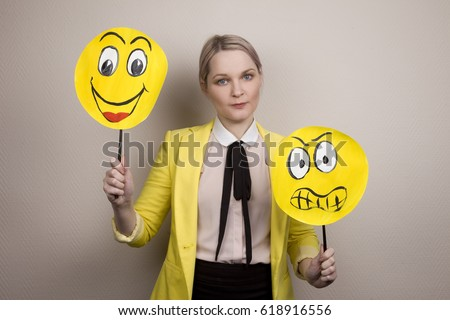 Development of emotional intelligence. The girl plays with smiles, builds faces. #618916556