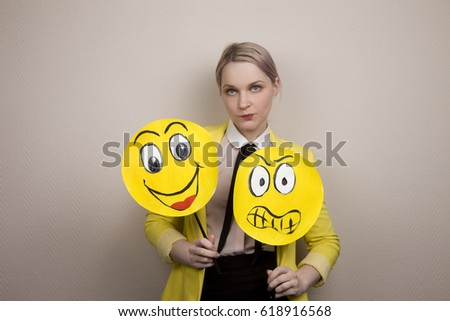 Development of emotional intelligence. The girl plays with smiles, builds faces. #618916568