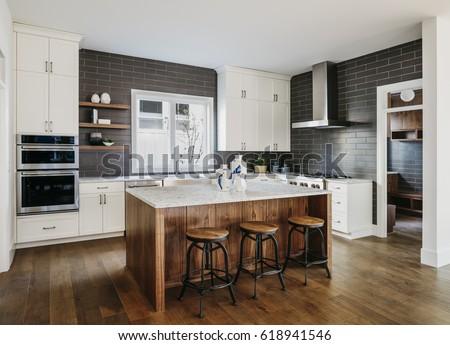 Modern kitchen with the hardwood floors. Portland, Oregon