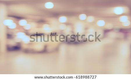 abstract blur image of indoor car park with bokeh for background usage . (vintage tone) #618988727