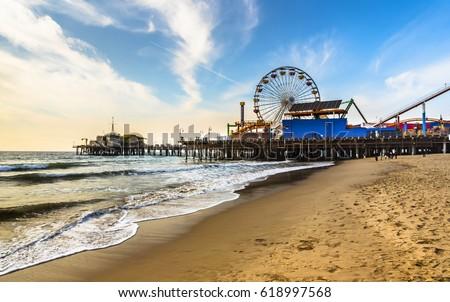 early morning winter Santa Monica pier beach sunny day Royalty-Free Stock Photo #618997568