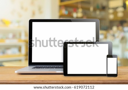 Laptop smartphone and tablet mockup with blank screen on table, Concept mockup. #619072112