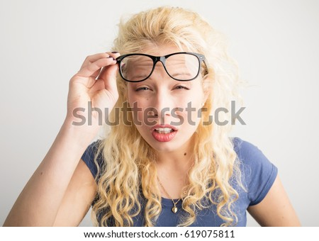 Woman with her glasses lifted up can't see Royalty-Free Stock Photo #619075811