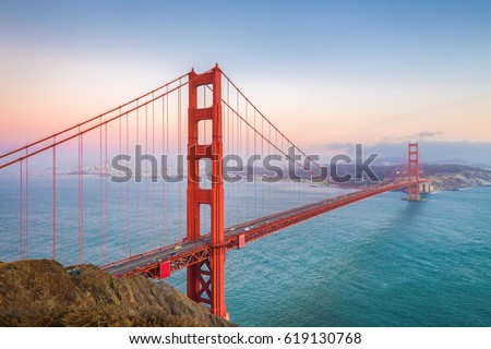 Classic panoramic view of famous Golden Gate Bridge seen from Battery Spencer viewpoint in beautiful post sunset twilight during blue hour at dusk in summer, San Francisco, California, USA #619130768