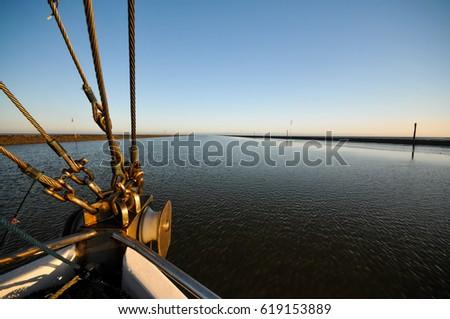 cutter Boat trip with a cutter through a tideway #619153889