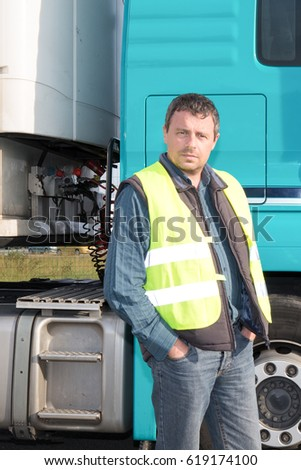 Driver delivery man beside his truck #619174100