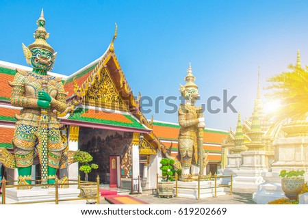 The Giant Demon Guardian with Temple and Blue Sky Background at Wat Phra Kaew, Grand Palace, Bangkok, Thailand. #619202669