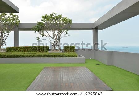 sky garden on rooftop of condominium with blue sky #619295843
