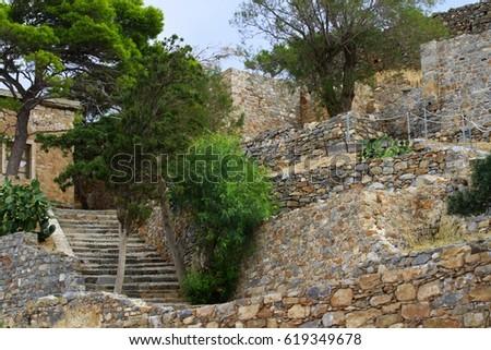 Stone architecture, stone steps, stone walls, trees, Crete, Greece #619349678