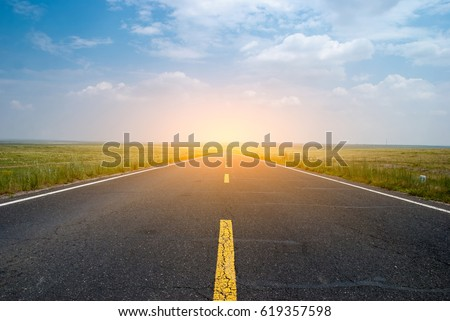 Beautiful grassland road in western China's Inner Mongolia Royalty-Free Stock Photo #619357598