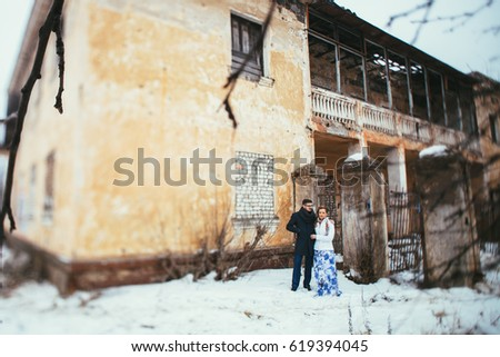 Winter wedding. Beautiful young couple in the old #619394045