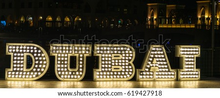 DUBAI - fluorescent Neon tube Sign - Front view - 3D, neon style lettering with dark background.
