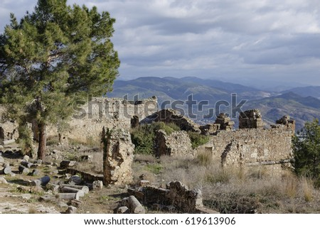 View of Ancient city of Syedra i Alanya province of turkey with mountain landscape on background #619613906