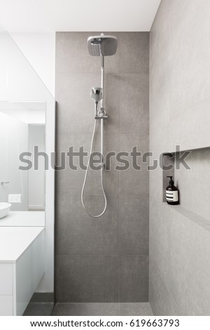 Luxury fully tiled shower with rain head and hand held shower rose #619663793