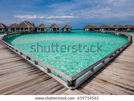 Beautiful beach with water bungalows at Maldives #619714562