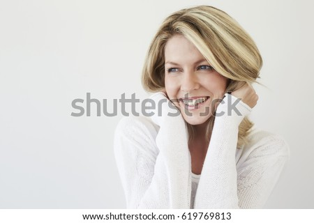 Beautiful smiling blond woman, studio Royalty-Free Stock Photo #619769813