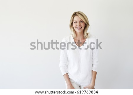 Blond and beautiful woman in white fashion Royalty-Free Stock Photo #619769834