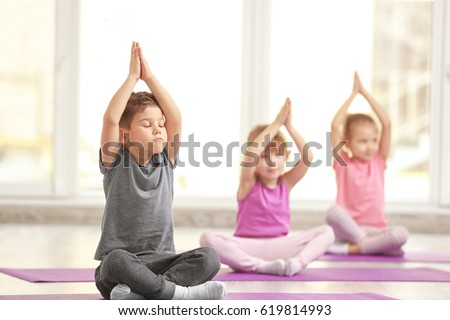 Group of children doing gymnastic exercises #619814993