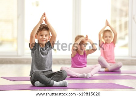 Group of children doing gymnastic exercises #619815020