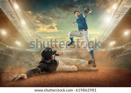 Baseball players in action on the stadium. #619862981