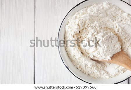Making dough, baking. Bowl with flour on wooden rustic kitchen table, top view, object, nobody #619899668