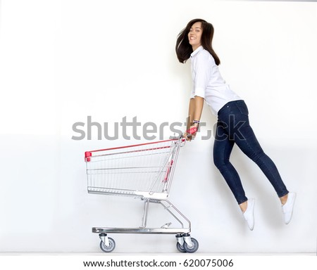 moving shot asian teen girl ijump with shopping cart in shopaholic concept #620075006