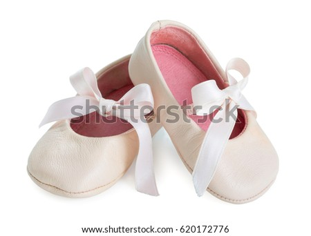 Pair of pink ballet shoes with bowknot for newborn baby. Isolated on a white background close up. #620172776