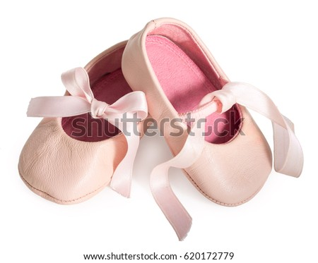 Pair of pink ballet shoes with bowknot for newborn baby. Isolated on a white background close up. #620172779