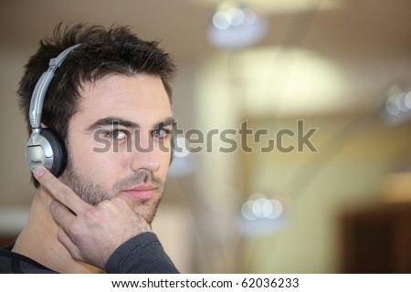 Portrait of a man listening to music #62036233