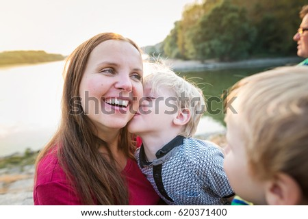 Mother with two sons at the lake, sunny spring day. #620371400