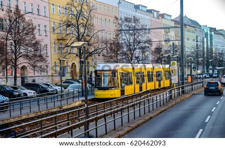 Yellow tram on the streets of Berlin #620462093