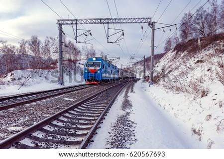Passenger train moves along Baikal lake. Trans Siberian railway. Russia. Royalty-Free Stock Photo #620567693