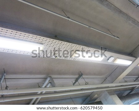 electric pipes on  concrete background wall #620579450