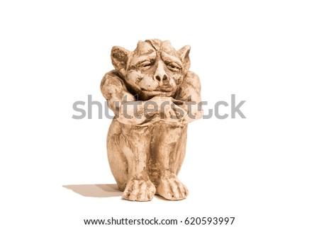 Isolated sitting gargoyle figurine on white background. With shadow. #620593997