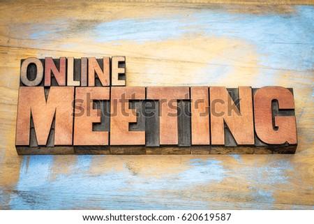 online meeting word in letterpress wood type against grunge wooden background #620619587