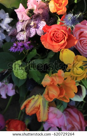 Mixed flower arrangement: various flowers in different colors for a wedding #620729264