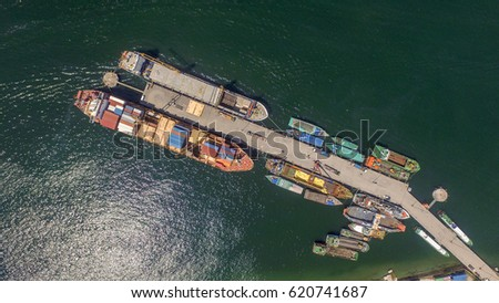 Aerial view of shipping containers waiting to be loaded on a cargo ship and vessels in Labuan port,Malaysia . #620741687