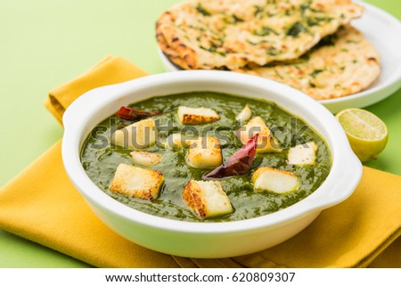 Palak Paneer Curry made up of spinach and cottage cheese, Popular Indian healthy Lunch/Dinner food menu, served in a bowl with Roti Or Chapati over moody background. selective focus #620809307
