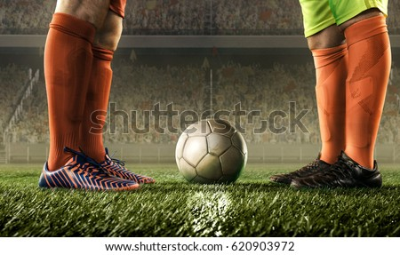 feet of soccer players before starting a match Royalty-Free Stock Photo #620903972