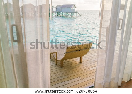 Beautiful tropical Maldives resort hotel with beach and blue water #620978054