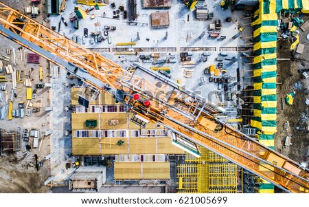 Busy Construction Site and Construction Equipment Aerial Photo