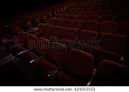 red velvet seats for spectators in the theater or cinema #621052553