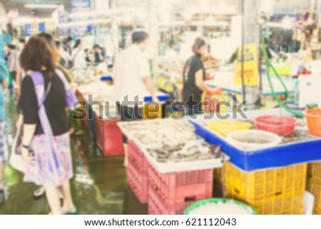 Abstract blur in the market for background #621112043