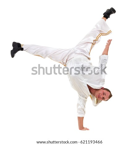 Disco dancer showing some movements against isolated white background #621193466