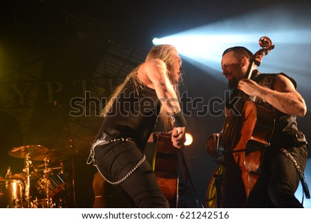 Berlin, Berlin / Germany October 5, 2015: Apocalyptica, cellos metal band from Helsinki (Finland), with cellos player Eicca Toppinen and Paavo Loetjoenen at concert in Columbia Halle in 2015. #621242516
