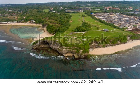 The rock that separates the two beaches - Balangan beach and Dreamland beach. Aerial view. #621249140